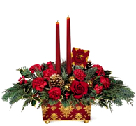 "Miami Christmas: A wonderful holiday mix of red carnations and roses, gold pinecones, gold glass balls and seasonal greens surrounding burgundy taper candles. Its all beautifully presented in a footed metal planter silkscreened with a baroque pattern in burgundy and gold metallic. 8""W x 4""D x 4 1/4""H. Set includes planter, two candles... ORDER NOW"