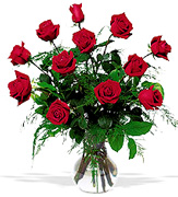 "Click and ""Order on Time"" your 12 Perfect RED Roses with a clear base, greens and white/green available fillers, Order now to Schedule Delivery"