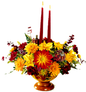 Miami Thanksgiving... This bouquet is the perfect recipe to complete your Thanksgiving table. We put together a great combination of Fall's best colors and flowers. All are decoratively arranged in a warm colored pedestal bowl. Two candles are included.
