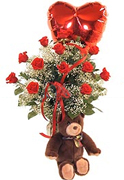 Click and Order on Time your PERFECT VALENTINE 12 Perfect RED Roses, TEDDY BEAR AND MYLAR BALLOON clear base, greens and white fillers, Order now to Schedule Delivery